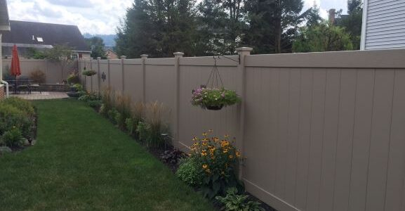 "This is the Certagrain Chesterfield privacy fence in Natural Clay. Fence is 6'h and includes an angled section (not pictured) to join an existing 5'h vinyl fence. Posts measure 5""x5"" and include matching New England caps. Click the catalog link for Certainteed on our Fence Vendors page for more information."