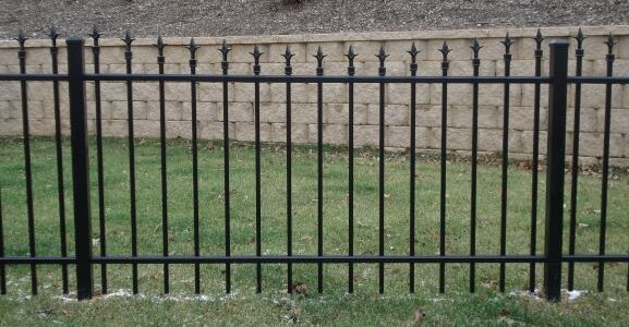 "Pictured is a Regis 2Rail concave aluminum fence in black with Tri-finial picket toppers. This fence measures 3'high and includes 1-3'w convex gate (not pictured). The Regis catalog link can be found on our ""Fence Vendors"" page."
